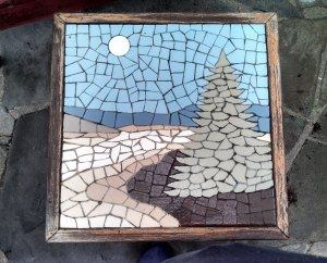 Top of an end table my father made.  He made the mosaic using ceramic tiles he cut up. Photo taken 2014.